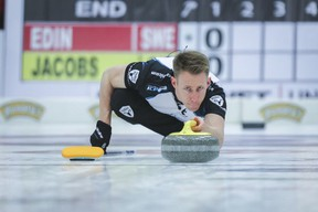 Courtesy Grand Slam of Curling  Team Jacobs third Marc Kennedy slides out of the hack in Grand Slam of Curling action
