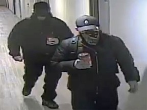 Kingston Police are searching for two men they said broke into two apartment buildings this month and stole property from residents.