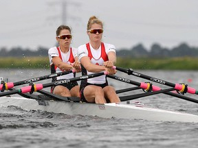 Canadian rowers Jenny Casson, front, of Kingston and Jill Moffatt of Bethany, Ont., in a women's lightweight double sculls race in an undated file photo.