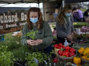 Christina Bouchard, left, and Chanel Bouchard, of Bouchard Gardens, work their booth at the season's first Amherstburg Farmer's Market held at GL Heritage Brewing in Amherstburg on Saturday, April 24, 2021.