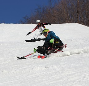 Photo by PAUL KAZULAK/FOR THE STANDARD Diane Morrell, a sit skier from Sault Ste. Marie, and her son Benny, skied at Mount Dufour Ski Area a number of times this past winter after adaptive equipment they needed was acquired.