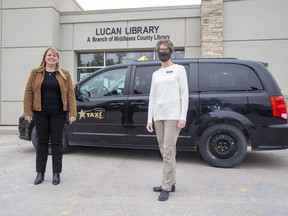 Lori Chouinard, president of Star Taxi, left, and Leigh Robinson, branch supervisor of the Lucan Public Library, helped launch a pilot project that offers free taxi rides to Middlesex County young people, as well as those in Exeter, so they can access mental health services in London. Derek Ruttan