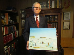 Ontario Superior Court Justice Joseph Donohue holds a painting depicting life during an earlier time in Kugluktuk, Nunavut in this 2015 file photo. Donohue, who retires from the bench this week, made several trips to Nunavut as a volunteer deputy judge.
