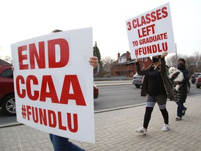 Laurentian and its federated universities' students, alumni, faculty, staff and community members, organized as Save Our Sudbury, participated in a rally in Sudbury, Ont. on Tuesday April 6, 2021. John Lappa/Sudbury Star/Postmedia Network