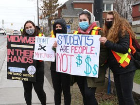 Protesters take part in a rally to fight Laurentian University program closures in Sudbury, Ont. on Friday April 16, 2021. John Lappa/Sudbury Star/Postmedia Network