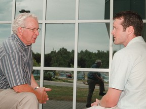 Geoff Tesson chats with first-year Northern Ontario School of Medicine resident Ian Symington in 2001.