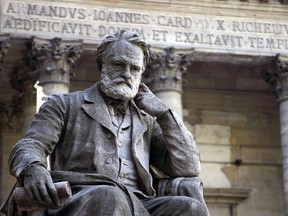 (FILES) This file photo taken on October 10, 2006 shows the statue of Victor Hugo near the chapel in the courtyard of the Sorbonne university in Paris.   He is worshipped as a saint in thousands of Vietnamese temples, held up as a prophet of European unity and a human rights hero for his campaigning against the death penalty.