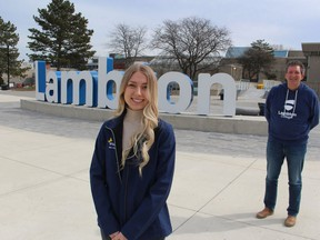 Andrea Dyck, with the Lambton College Enactus team, and staff adviser Jon Milos are shown outside the Sarnia school's main building. File photo/Postmedia Network