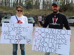Garrett and Candice Readings of Simcoe were among several hundred protesters at a No More Lockdowns rally held Saturday.