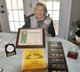 "Caroline Vivian, of Mitchell, holds her 40-year certificate with 4-H Ontario she was presented last month. She also has displayed other 4-H memorabilia over the last four decades, including their first club ""Which Came First - The Chicken Or The Egg?"" ANDY BADER/MITCHELL ADVOCATE"