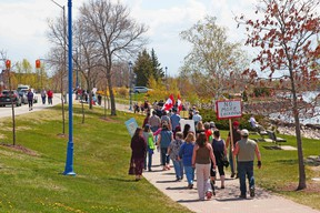 About 75 people march along the North Bay Waterfront, Saturday, as part of a 'Freedom Rally' protesting COVID-19 restrictions. Michael Lee/The Nugget