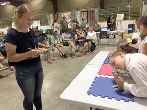Judge Molly Sayers smiles during the rabbit show at the Dresden Exhibition in this file photograph from 2019. File photo/Courier Press