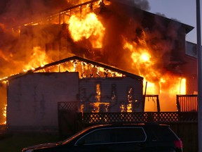 Fire crews responded to calls of a house fire in Devon over the long weekend, May 23. RCMP are investigating the fire as well as reports of shots being fired in the area. (Supplied by Rick Pearson)