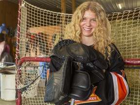 Taya Currie, a goaltender with the AAA U16 Elgin-Middlesex Chiefs, has a chance next month to become the first female player chosen in an Ontario Hockey League draft. She was photographed in her family's barn in Parkhill on Sunday May 2, 2021. Mike Hensen/The London Free Press/Postmedia Network