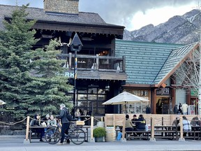It's patio time of year again in Banff. Visitors and residents sat outside establishments on Banff Ave adhering to the outdoor dining restriction guidelines on Saturday, May 1. The 100, 200 and part of the 300 block of Banff Avenue is now closed to vehicles in the downtown pedestrian zone. This closure will last all summer. Photo Marie Conboy/ Postmedia.