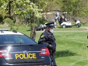 OPP monitor The Bridges at Tillsonburg, a golf course that opened in defiance of the provincial stay-at-home order. (Chris Abbott, Postmedia Network)