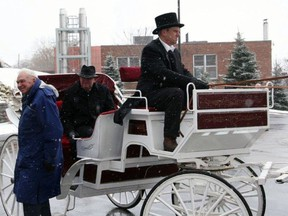 Dr. Jim Digby arrives at Brantford General Hospital's 125th anniversary celebration by horse-drawn carriage. Seated is then Brantford mayor Mike Hancock.