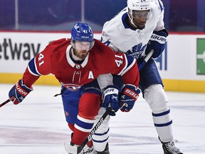 Paul Byron (left) of the Montreal Canadiens skates against Wayne Simmonds of the Toronto Maple Leafs during overtime in game six of their best-of-seven NHL playoff series on Saturday night. Montreal won 3-2 to tie the series and force a seventh and deciding game Monday night. Minas Panagiotakis/Getty Images