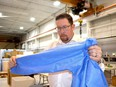 Windsor-based Harbour Technologies is expanding is personal protective equipment manufacturing operations to Chatham-Kent. Co-owner David Glover is seen here with one of the PPE gowns the company manufacturers. He says the Chatham plant ill be hiring as many as 80 new employees. Handout