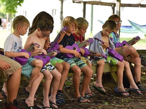 Children play ukuleles at Kenesserie Camp near Ridgetown in 2019. The camp has decided to cancel its summer overnight program for children this year.