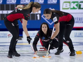 Calgary Ab,May 8, 2021.WinSport Arena at Calgary Olympic Park.LGT World Woman's World Curling Championship.Team Canada skip Kerri Einarson of Gimli Mb follows her front end (L-R) lead Briane Meilleur and 2nd.Shannon Birchard during their qualification game against team Sweden.