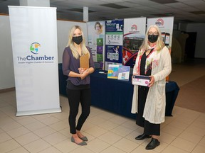 Jessica Colvin, left, and Karen Cross of the Greater Kingston Chamber of Commerce visit the rapid COVID-19 test distribution centre. The chamber acquired 50,000 rapid tests kits for local businesses.