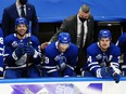 Toronto Maple Leafs head coach Sheldon Keefe congratulates Toronto Maple Leafs forward Jason Spezza (19) on his hat trick along with forward John Tavares (91)  and forward Auston Matthews (34) during the third period at Scotiabank Arena on Feb. 4. Toronto defeated Vancouver.