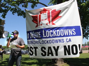 One of the organizers of the first Freedom Rally in Pembroke, held to protest government lockdowns, and to promote opening businesses back up, addresses the crowd at Riverside Park in Pembroke on May 29.The man identified himself as Gerry but did not want to give his last name.