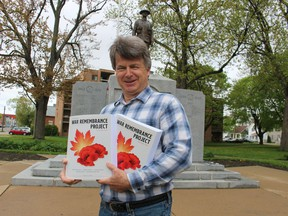 Retired Sarnia teacher Tom Slater holds the two volume third edition of The Sarnia War Remembrance Project he recently completed, telling the stories of the Sarnia-area's war dead and the communities' experiences during wartime.