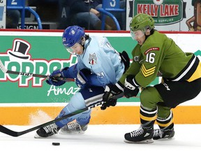 Chase Stillman, left, of the Sudbury Wolves, and Nick Grima, of the North Bay Battalion, battle for the puck during OHL action at the Sudbury Community Arena in Sudbury, Ont. on Friday January 10, 2020. John Lappa/Sudbury Star/Postmedia Network
