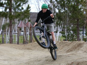 Connor Woods works on his biking skills on a pump track at Kivi Park in Sudbury, Ont. Thursday will be sunny with a high of 20 degrees C. John Lappa/Sudbury Star/Postmedia Network