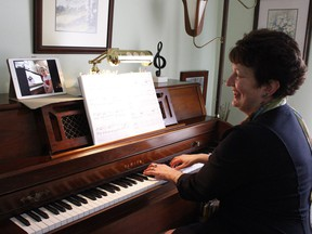 Lynn Pigeon, a registered music teacher and the president of the Ontario Registered Music Teacher's Association in Timmins, uses FaceTime to conduct a piano lesson with one of her students.   RICHA BHOSALE/The Daily Press
