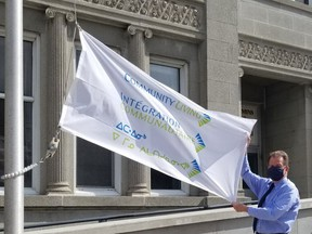 Timmins Mayor George Pirie raised a flag at city hall Thursday, proclaiming May as Community Living Month. Community Living Timmins assists people with intellectual disabilities by providing various programs and support for them.  Supplied