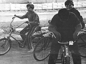 THE SEASON IS HERE- The past warm days would seem to have doubled the young population of Cochrane, mostly on bicycles. Students Andy Beaulne (left), Noel Leonard and Dwain Theriault pause for a chat before taking off.