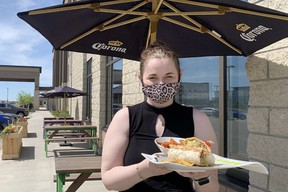 As part of the province's Stage 1 reopening plan, restaurant patios reopened on Tuesday for tables of four people from the same household or two contacts of people who live alone. Lindsay Morey/News Staff
