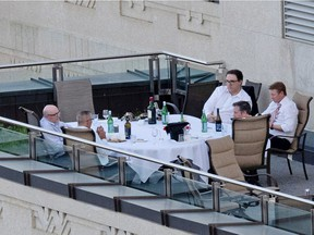 Premier Jason Kenney and some cabinet ministers are pictured on a patio in the Federal Building in Edmonton taken on June 1, 2021. From the top right is Environment & Parks Minister Jason Nixon, Minister of Environment & Parks, Health Minister Tyler Shandro, Kenney, Finance Minister Travis Toews and an unidentifiable man. Photo Supplied