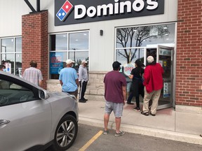 Line-ups of people waited patiently – and socially-distanced – May 29 at Domino's Port Elgin to pick up their pizzas. A donation of $5 per pizza will be made by Domino's to the family of the late Jose Coronado, a Hi-Berry Farm Mexican worker who died of natural causes in April in Port Elgin. [Supplied]