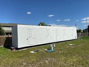 The trailer in question sits primed thanks to David Bowman Painting, and is ready for volunteers to paint a new mural for Luxstone residents.