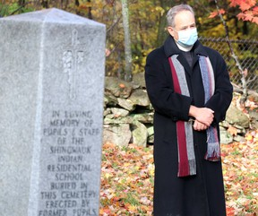 Dean James McShane, of St. Luke's Cathedral, visits Shingwauk Cemetery at Algoma University on Saturday, Oct. 17, 2020 in Sault Ste. Marie, Ont. (BRIAN KELLY/THE SAULT STAR/POSTMEDIA NETWORK)