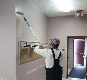 Mike Minderline worked on repainting Whitecourt and District Public Library in preparation for its reopening Monday, June 21. The library continues to offer contactless services in the meantime.