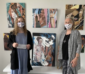 Kira Wencel (L) accepts a cheque for $1,000 from Mary Faubert (R). They stand before two of Wencel's art pieces - top left and centre. Hannah MacLeod/Kincardine News