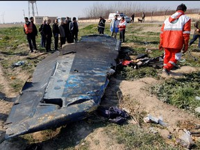 General view of the debris of the Ukraine International Airlines, flight PS752, Boeing 737-800 plane that crashed after take-off from Iran's Imam Khomeini airport, on the outskirts of Tehran, Iran Jan. 8, 2020 is seen in this screen grab obtained from a social media video via REUTERS.