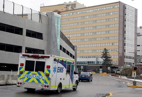 An ambulance is seen driving into the emergency entrance of the Foothills Medical Centre. Wednesday, December 9, 2020. Two patients who tested positive for the COVID-19 Delta variant at theFoothills facility have died, in what are believed to be the first such deaths in Alberta.