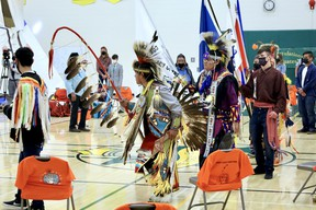"""Memorial Composite High School (MCHS) students and members of Paul First Nation conduct the grand entry of the flags during Parkland School Division's """"Cultural Graduation Celebration"""" on Tuesday, Jun. 15, 2021. Photo by Rudy Howell/Postmedia."""