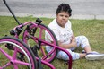 Nine-year-old Aaliyah Faulknor sits beside the remnants of her custom made wheelchair that was stolen and irreparably damaged in London. (Derek Ruttan/The London Free Press)