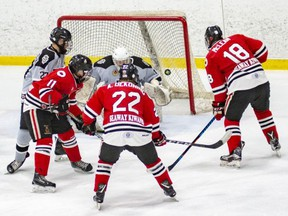 Sarnia Legionnaires forwards Nolan DeGurse (11), Alec DeKoning (22) and Isaac McLean (18) storm the LaSalle Vipers' net in the opening game of their GOJHL playoff series at Sarnia Arena in Sarnia, Ont., on Thursday, Feb. 28, 2019. (SHAWNA LAVOIE/Special to the Observer)