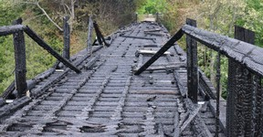 The burned trestle bridge on the Bruce County rail trail over Willow Creek near Paisley.