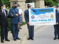 Members of 8 Air Maintenance Squadron and 418 Wing RCAFA members join Bill Robertson in a small socially-distanced visit to celebrate his 100th birthday in Trenton Belleville, Ontario on June 11, 2021. Squadron members respected public health measures throughout the celebration. SUBMITTED PHOTO
