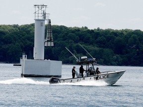Members of the Ontario Provincial Police's Leeds and Grenville Marine Unit pass a range marker on Butternut Bay as they continue their search for a missing 27-year-old man on Sunday morning. (RONALD ZAJAC/The Recorder and Times)