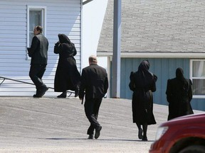Churchgoers arrive for a service at the Old Colony Mennonite Church in Wheatley, Ont., on Sunday, June 6, 2021. (Mark Malone/Chatham Daily News)